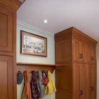 Custom framing should always match the overall style of the room.  The wood frame and dark mat of this custom frame fit perfectly in this traditional mudroom.  Get a free account and conceive your perfect wooden picture frame at framed & matted.