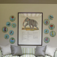 Bigger is better when it comes to elephants.  This large print, in a black wood frame, is balanced by decorative plates.  For an eclectic touch, mix different decorations in the same space.  Get started today and conceive a low-cost silver frames online.