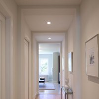 Silver wood frames line this Minneapolis hallway, adding some visual interest, while maintaining a crisp and clean feeling.  Get this look at framed & matted.  Get started today and create a low-cost modern frames online.
