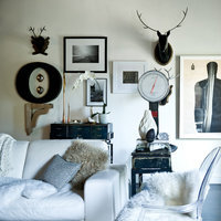 What compliments deer antlers and a vintage doctors scale? Black and white photos in custom frames!  Mixing modern frames with flea market finds makes for a fun and distinct room.  Work with an expert and conceive your cheap matted frame at framed & matted.