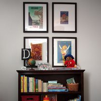 Layer some fun kid friendly art in a simple grid like this Austin designer. Not sure what to frame, how about custom framing a dust jacket of you kids' favorite books?  Click here for more information and construct your low-cost white frames at framed & matted.