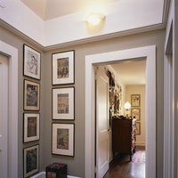 Have a narrow wall? Fill it with custom frames to maintain a clean look. Hang framed art vertically and eliminate the need for a piece of furniture, which may clutter the space.  Get expert advice and construct your low-cost photography art frame online.