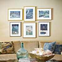 Different sizes and styles of custom picture frames are used for these Japanese prints, yet the pieces are arranged in a pattern that balances this eclectic Austin Living Room.  Get started today and buy your cheap gold picture frames online.