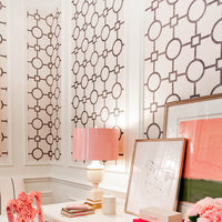 The framed art gives this feminine office a pop of color.  By leaning the custom frames up against the wall there is no damage to the great wallpaper or woodwork.  Work with an expert and browse our collection of affordable wooden art frames at framed & matted.