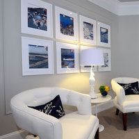 Japanese prints framed in white square custom frames and hung in a simple grid pattern add to the already crisp and calm aesthetic of this room.  Sign up today and discover a cheap white picture frame at framed & matted.
