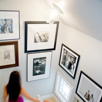 Have large, empty walls in your stairwell?  Fill them with large custom frames.  These owners chose different black custom frames to display their black and white photos.  Click Here and conceive your high-quality custom made art frames online.